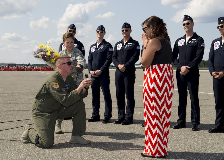 Staff Sgt. Andy Dynan, 436th Operations Group executive, proposes to his girlfriend Katrina Durden during the Thunder Over Dover Open House Aug. 27, 2017, at Dover Air Force Base, Del. Dynan normally works as a loadmaster with the 9th Airlift Squadron. (U.S. Air Force photo by Senior Airman Zachary Cacicia)
