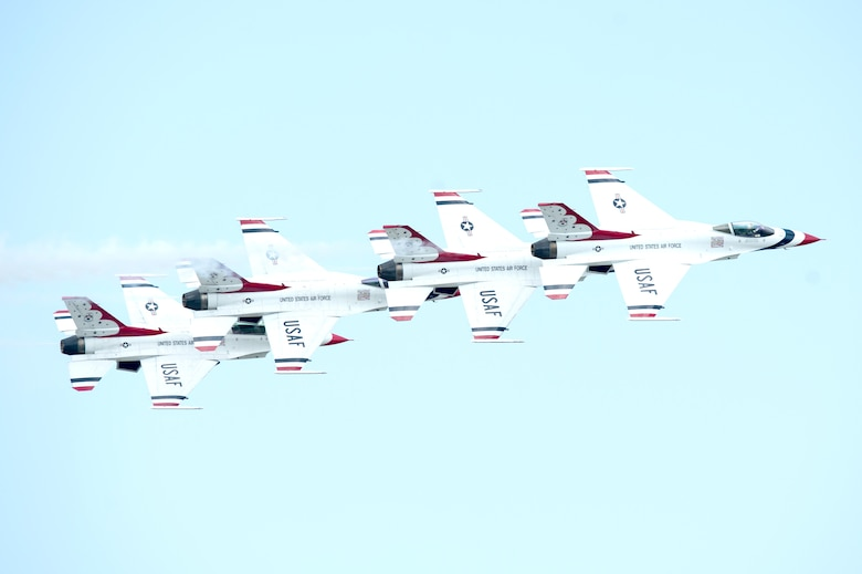 The United States Air Force Thunderbirds perform aerial maneuvers during the Thunder Over Dover Open House and Airshow Aug. 25, 2017, at Dover Air Force Base, Del. The Thunderbirds demonstrated the versatility of the F-16 Fighting Falcon by performing aerial acrobatics, precision formations and high-speed passes during their performance. (U.S. Air Force photo by Mauricio Campino)