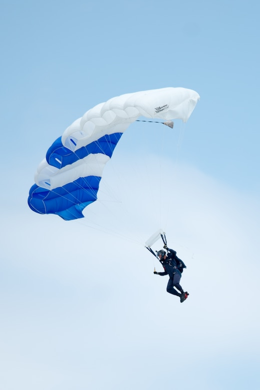 A member of the Wings of Blue parachute team sky dives during the opening ceremony of the Thunder Over Dover Open House and Airshow Aug. 25, 2017, at Dover Air Force Base, Del. This was the first open house held at Dover AFB in eight years. (U.S. Air Force photo by Mauricio Campino)