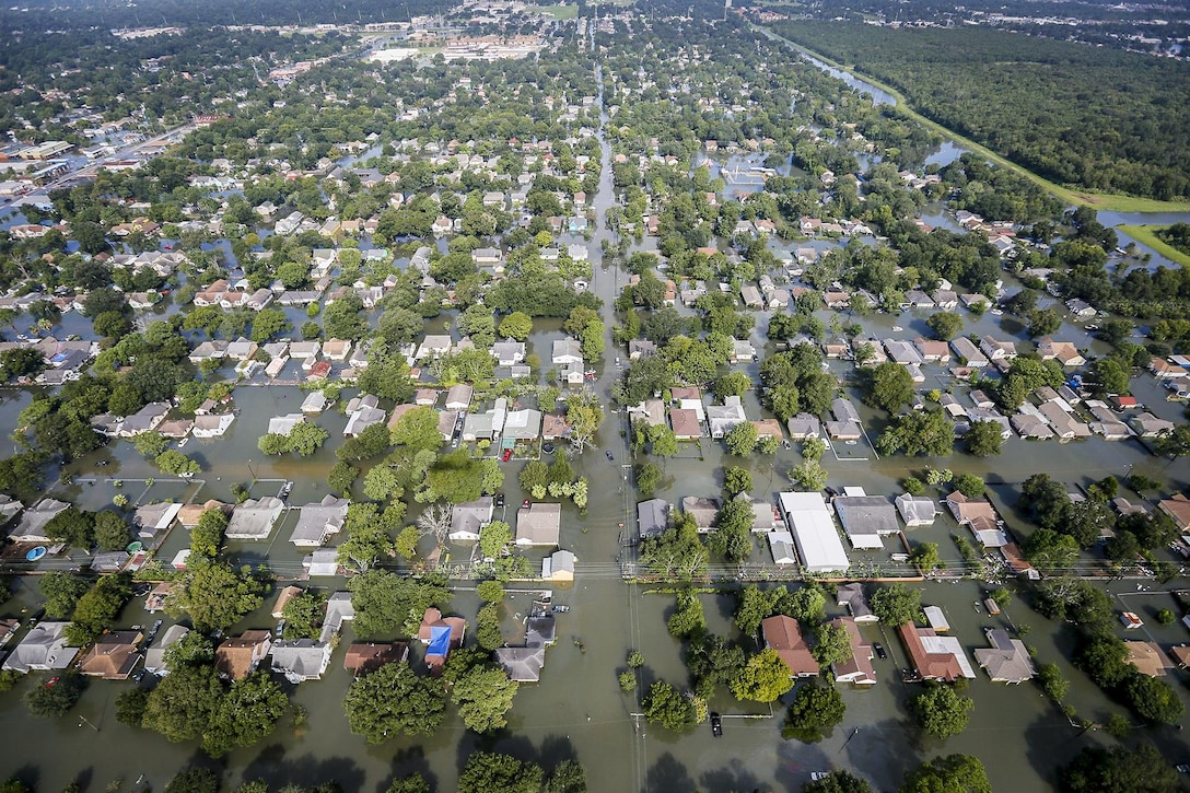 An aerial shows extensive flooding in a residential area from Hurricane Harvey in Texas.