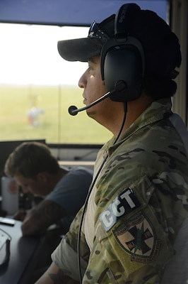 Air Force Tech. Sgt. Daniel Resendez, 350th Battlefield Airman Training Squadron combat controller, communicates with helicopters crossing at Joint Base San Antonio Randolph auxiliary airfield in Seguin, Texas, Sept 1, 2017. Resendez is supporting Federal Emergency Management Agency disaster-relief efforts in the aftermath of Hurricane Harvey. Air Force photo by Tech. Sgt. Chad Chisholm