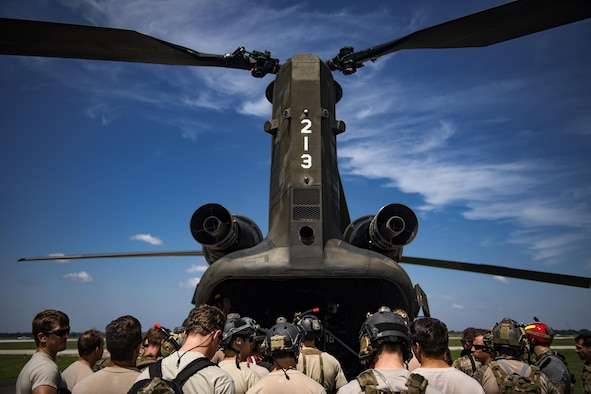 Pararescuemen from the 48th and 58th Rescue Squadrons gather around a CH-47 Chinook prior to setting up boat rescue operations, Aug. 30, 2017, at Easterwood Airport, College Park, Texas.
