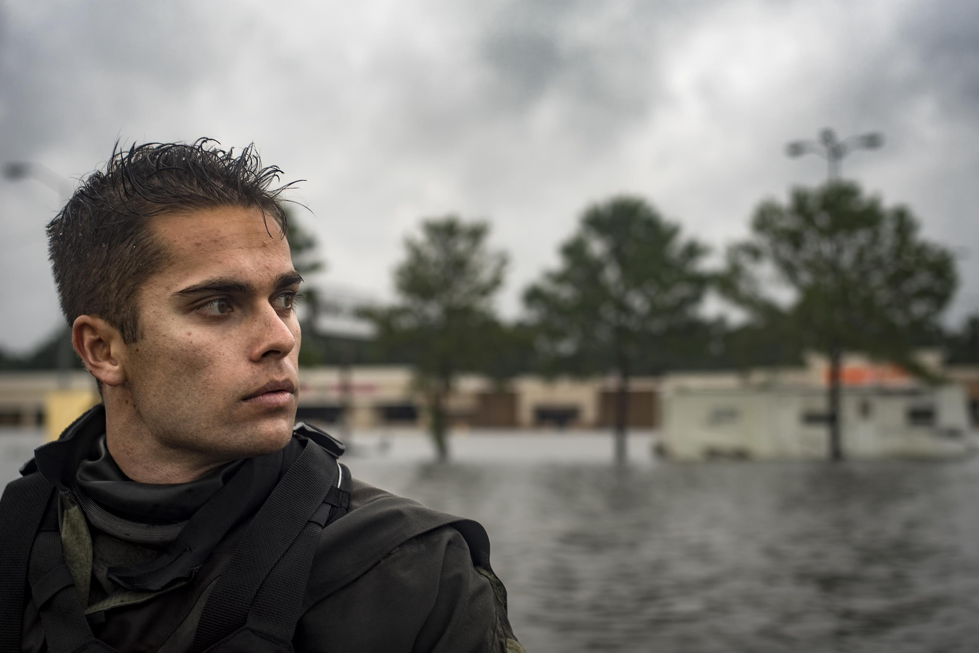 A pararescueman from the 58th Rescue Squadron surveys the flood waters from a rescue boat, Aug. 30, 2017, in Orange, Texas.