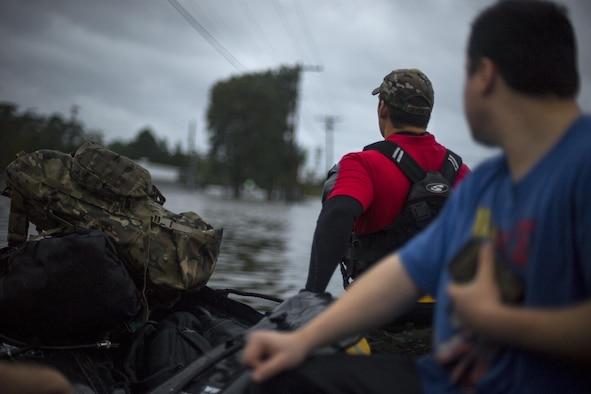 A pararescueman from the 58th Rescue Squadron pulls a boat carrying victims of Hurricane Harvey, Aug. 30, 2017, in Orange, Texas.