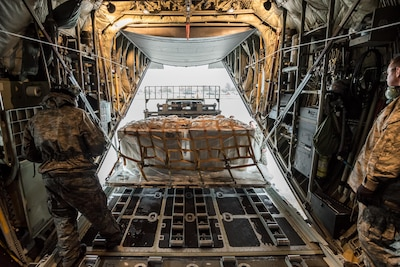 Aerial porters from the 123rd Airlift Wing load a pallet of cargo nets onto a C-130 Hercules aircraft at the Kentucky Air National Guard base in Louisville, Ky., Sept. 1, 2017. The aircraft is one of two that will carry 14 Kentucky Air Guardsmen to Texas, where they will fly humanitarian aid and airlift evacuation missions in the aftermath of Hurricane Harvey. Air National Guard photo by Lt. Col. Dale Greer