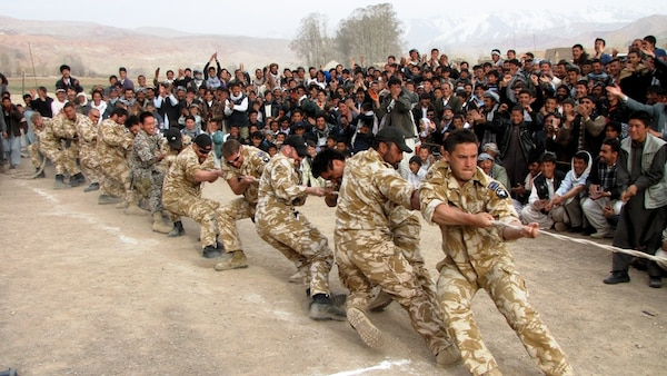 In 2010, the New Zealand Provincial Reconstruction Team participates in a tug-a-war challenge between teams from the various villages around Bamyan Province in Afghanistan.