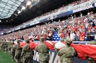 Service members from the Army and Air Force walk into Red Bull Arena Sept. 1 prior to a U.S. Men's Soccer game.  The service members were there to hold the U.S. flag for the national anthem as part of a military appreciation theme for the game.