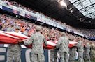 Service members from the Army and Air Force walk into Red Bull Arena Sept. 1 prior to a United States men's national soccer team game.  The service members were there to hold the U.S. flag for the national anthem as part of a military appreciation theme for the game.