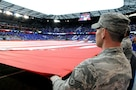 An Air Force Staff Sgt. helps hold the U.S. flag Sept. 1 during a U.S. Men's Soccer game at Red Bull Arena in Harrison, New Jersey.  The service members were there to hold the flag for the national anthem as part of a military appreciation theme for the game.