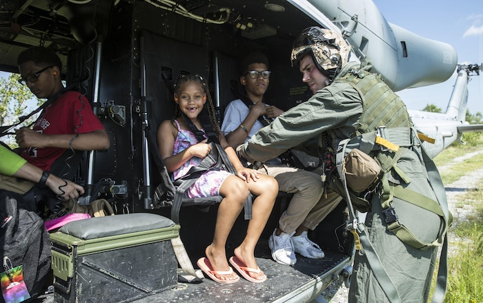 Marines with Detachment A, Marine Light Attack Helicopter Squadron 773, 4th Marine Aircraft Wing, Marine Forces Reserve, ensures a family is safely escorted to a safe location during a rescue mission in wake of Hurricane Harvey in Port Arthur, Texas, August 31, 2017. The Marine Corps Reserve is America's expeditionary total force in readiness that is always the first to fight, whether on the battlefield or national emergencies.