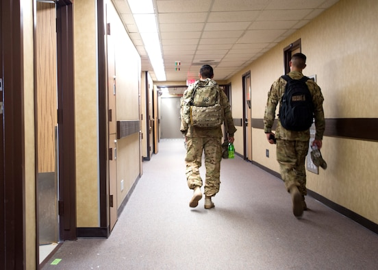 Soldiers walk to their assigned rooms on Sept. 2, at the old Wilford Hall Ambulatory Surgical Center on Joint Base San Antonio-Lackland, Texas. More than 500 soldiers are awaiting future deployment instructions at the old Wilford Hall in response to the devastation caused by Hurricane Harvey. (U.S. Air Force photo/Staff Sgt. Kevin Iinuma)