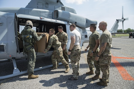 LAKE CHARLES, LA – U.S. service members load supplies onto a Marine UH-1Y helicopter from Detachment A, Marine Light Attack Helicopter Squadron 773, 4th Marine Aircraft Wing, Marine Forces Reserve.  Marines conducted an aerial re-supply in support of relief efforts in the wake of Hurricane Harvey in Port Arthur, Texas, Sep. 2, 2017.  (U.S. Marine Corps photo by Cpl. Kimberly Aguirre/Released)