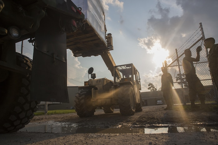 A Marine Corps Kalmar RT-022 from 14th Marine Regiment, 4th Marine Division, Marine Forces Reserve, removes a pallet of supplies form a Marine Corps 7-ton Truck outside a Red Cross warehouse in Beaumont, Texas, Sept. 2, 2017. 14th Marines, based out of Fort Worth, Texas, traveled to Beaumont to transport supplies to locals affected by Hurricane Harvey which devastated areas of eastern Texas.