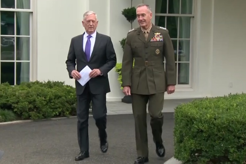 Defense leaders walk away from White House.