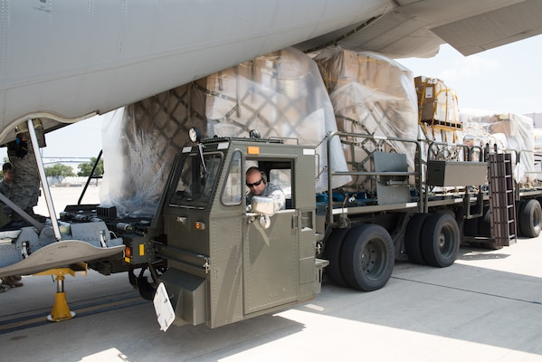 Members with 502nd Logistics Readiness Squadron and U.S. Army Soldiers unload a Royal Canadian Air Force CC-130J Hercules at Joint Base San Antonio-Lackland Kelly Field, Texas carrying humanitarian supplies from the government of Canada to aid in Hurricane Harvey relief efforts Sept. 3, 2017. The supplies included pediatric necessities like baby formula, blankets, cribs and other similar items. The RCAF airlift flew in from 8 Wing Trenton, Ontario, Canada.