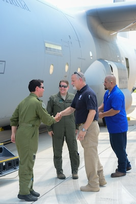 Mr. Scott Thomas, Federal Emergency Management Agency  Director of Hurricane Harvey Relief Efforts in Texas (center right), greets Royal Canadian aircrew pilot Capt. Daniel Ebisuzaki (left) and U.S. Air Force pilot Maj. Kimberley Sercel (middle), of a CC-130J Hercules at Joint Base San Antonio-Lackland Kelly Field Texas carrying humanitarian supplies from the government of Canada to aid in Hurricane Harvey relief efforts Sept. 3, 2017. The supplies included pediatric necessities like baby formula, blankets, cribs and other similar items. The RCAF airlift flew in from 8 Wing Trenton, Ontario, Canada.