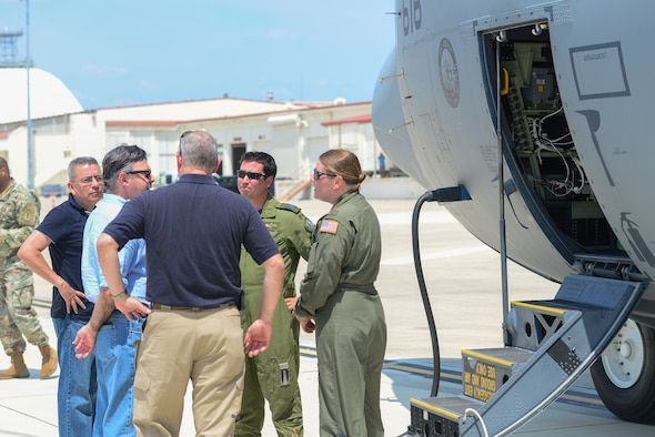 Mr. Vasken Khabayan (second from left), Acting Consul General of Canada in Dallas, greets the Royal Canadian aircrew pilot Capt. Daniel Ebisuzaki (second from right) and U.S. Air Force pilot Maj. Kimberley Sercel (right) of a CC-130J Hercules at Joint Base San Antonio-Lackland Kelly Field, Texas carrying humanitarian supplies from the government of Canada to aid in Hurricane Harvey relief efforts Sept. 3, 2017. The supplies included pediatric necessities like baby formula, blankets, cribs and other similar items. The RCAF airlift flew in from 8 Wing Trenton, Ontario, Canada.