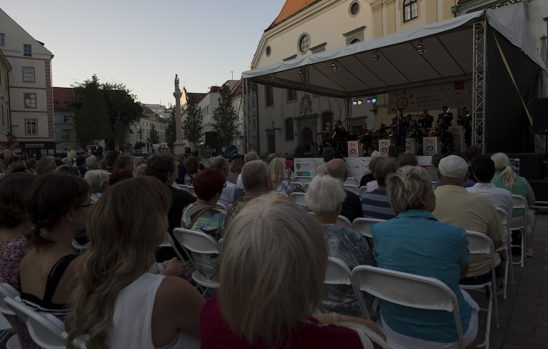 Members of The Ambassadors, U.S. Air Forces in Europe jazz band, perform before an audience for the 73rd anniversary of the Slovak National Uprising in Bratislava, Slovakia, Aug. 30, 2017. The band also played at the Museum of Slovak National Uprising in Banská Bystrica, Slovakia, for the celebration. The USAFE Band's performance will help preserve the mutual commitment and trust between the U.S. and Slovakia. (U.S. Air Force photo by Senior Airman Tryphena Mayhugh)