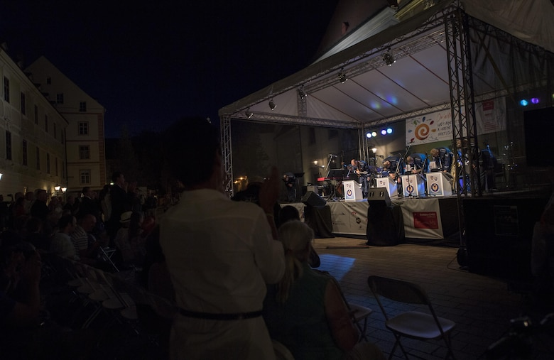 Members of The Ambassadors, U.S. Air Forces in Europe jazz band, take a bow after performing a concert for the 73rd anniversary of the Slovak National Uprising in Bratislava, Slovakia, Aug. 30, 2017. The jazz band, known as the Ambassadors, was comprised of 13 Airmen for this performance, to include saxophones, trombones, trumpets, percussion, and bass players. The USAFE band represents unique international musical heritage, building and preserving partnerships through official multi-national military and international community outreach events. (U.S. Air Force photo by Senior Airman Tryphena Mayhugh)