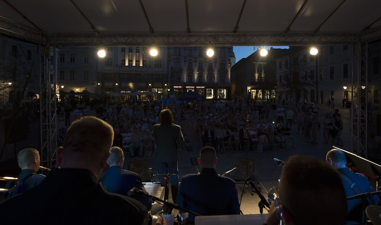 U.S. Air Force Master Sgt. Michele Harris, U.S. Air Forces in Europe vocalist, sings while other members of the band play instruments for the 73rd anniversary of the Slovak National Uprising in Bratislava, Slovakia, Aug. 30, 2017. The band was invited to perform for the event held at the Museum of Slovak National Uprising, as well as in the nation's capital, Bratislava. The USAFE Band's performance will help preserve the mutual commitment and trust between the U.S. and Slovakia. (U.S. Air Force photo by Senior Airman Tryphena Mayhugh)