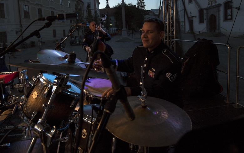 U.S. Air Force Staff Sgt. Andy Wendzikowski, U.S. Air Forces in Europe percussion, plays the drums for the 73rd anniversary of the Slovak National Uprising in Bratislava, Slovakia, Aug. 30, 2017. The USAFE band, known as the Ambassadors, was invited to perform for the celebration. Participating in events with NATO allies improves interoperability and strengthens long standing relationships. (U.S. Air Force photo by Senior Airman Tryphena Mayhugh)