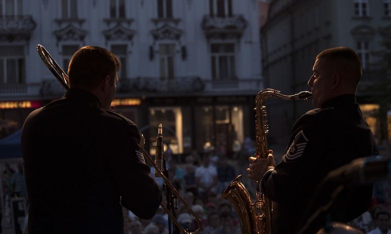 """U.S. Air Force Master Sgt. John Dawson, U.S. Air Forces in Europe jazz band saxophone (right), and U.S. Air Force Staff Sgt. James Hubbard, USAFE jazz band trombone (left), """"battle"""" with their instruments during a concert for the 73rd anniversary of the Slovak National Uprising in Bratislava, Slovakia, Aug. 30, 2017. The U.S. established diplomatic relations with Slovakia in 1933. Since then, the two countries have maintained a strong bilateral friendship based on shared values and mutual interests. (U.S. Air Force photo by Senior Airman Tryphena Mayhugh)"""