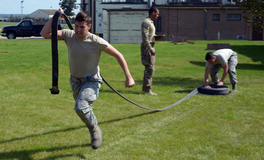 Airman races to carry hose