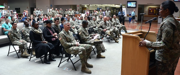 Brooke Army Medical Center Deputy Commander Col. Traci E. Crawford addresses the audience gathered for BAMC's Women's Equality Day in the Medical Mall Aug. 30. Crawford was the guest speaker for the event.