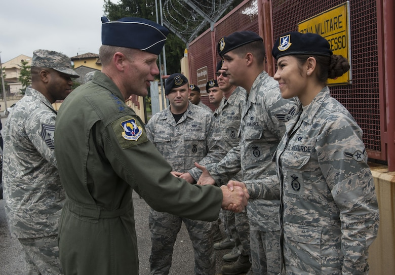 Gen. Tod Wolters, U.S. Air Forces in Europe and Air Forces Africa commander, presents Airman Jacquelyn Harvey, 31st Security Forces Squadron security response team member, with a coin on Sept. 1, 2017, at Aviano Air Base, Italy. During his visit he toured several base facilitates, met with the 31st Fighter Wing leadership and visited Airmen around base. (U.S. Air Force photo by Staff Sgt. Krystal Ardrey)