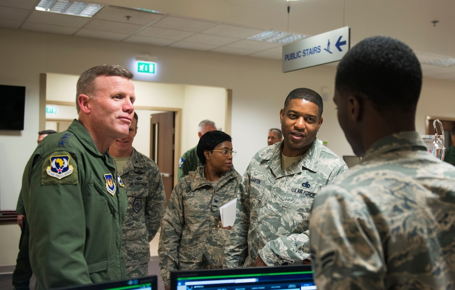 Gen. Tod Wolters, U.S. Air Forces in Europe and Air Forces Africa commander, and Chief Master Sgt. Phillip Easton, USAFE-AFAFRICA command chief, speak with an Airman from the 31st Medical Group on Sept. 1, 2017, at Aviano Air Base, Italy. During his visit he toured several base facilitates, met with wing leadership and visited Airmen. (U.S. Air Force photo by Staff Sgt. Krystal Ardrey)
