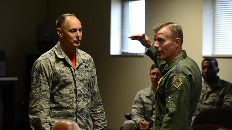 Gen. Tod Wolters, U.S. Air Forces in Europe and Air Forces Africa commander, speaks with Senior Master Sgt. Morgan Ard, 31st Munitions Squadron weapons flight chief, Sept. 1, 2017, at Aviano Air Base, Italy. During his visit he met with many Airmen and toured several base facilities. (U.S. Air Force photo by Airman 1st Class Ryan Brooks)