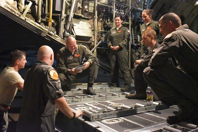 An aircrew is briefed before leaving its home base.