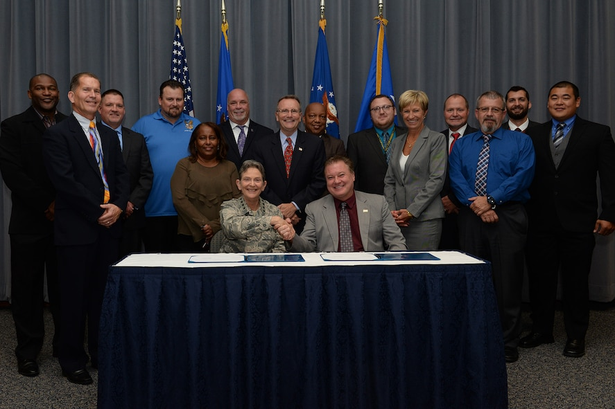 Gen. Ellen M. Pawlikowski, Air Force Materiel Command commander; Troy Tingey, American Federation of Government Employees Council 214 president; and the Master Labor Agreement negotiation teams pose for a group photo after the Master Labor Agreement signing ceremony at Headquarters Air Force Materiel Command Aug. 23, 2017. (U.S. Air Force photo/Michelle Gigante)