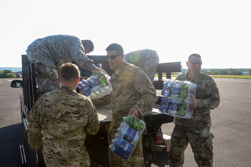 Pennsylvania National Guard soldiers load bottled water onto a CH-47 Chinook helicopter at Fort Indiantown Gap, Pa., in preparation to depart for the Hurricane Harvey relief effort in Texas, Sept. 1, 2017. Pennsylvania Army National Guard photo by Sgt. Zane Craig