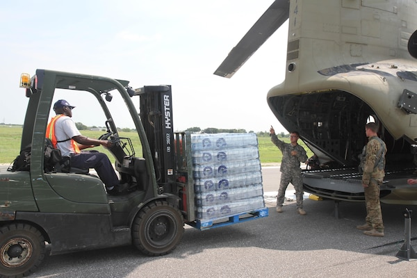Soldiers with 2nd Battalion, 501st Aviation Regiment from Fort Bliss, Texas, help load pallets of water onto a CH-47 Chinook at Joint Base San Antonio-Seguin Auxiliary Airfield in Seguin, Texas as part Hurricane Harvey Relief efforts Sept. 3. One pallet contained 2,375 pounds of bottled water for citizens affected by Harvey.