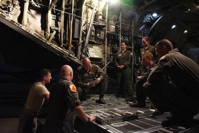 The crew of a C-130 Hercules flown by the Illinois Air National Guard's 182nd Airlift Wing conducts a preflight briefing before a late-night departure from their home base of Peoria, Ill., Sept. 2, 2017. Illinois Air National Guard photo by Master Sgt. Todd A. Pendleton