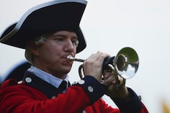 """A member of the U.S. Army Old Guard Fife and Drum Corps performs during the """"Music Under the Stars"""" season finale concert at Joint Base Langley-Eustis, Va., Aug. 31, 2017."""