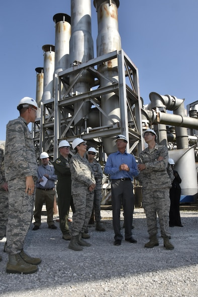 Gen. Ellen M. Pawlikowski, Air Force Materiel Command commander (center); Maj. Gen. David Harris, Air Force Test Center commander (left of center); and Col. Scott Cain, Arnold Engineering Development Complex commander (right), receive a facility briefing and tour of the AEDC Aeropropulsion Systems Test Facility by staff members Aug. 22, 2017. (U.S. Air Force photo/Rick Goodfriend) (This image was manipulated by obscuring badges for security purposes.)