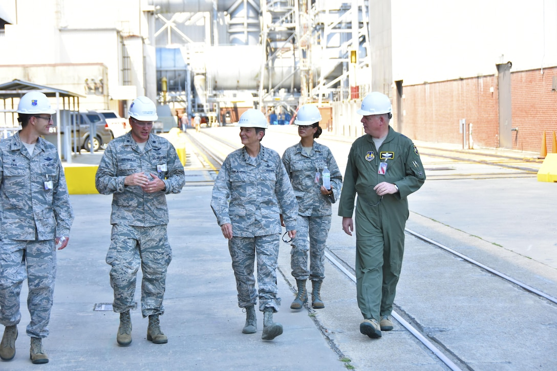 Gen. Ellen M. Pawlikowski, Air Force Materiel Command commander (center); Maj. Gen. David Harris, Air Force Test Center commander (right); and Col. Scott Cain, Arnold Engineering Development Complex commander (left), receive a facility briefing and tour of the Propulsion Wind Tunnels by Lt. Col. David Hoffman (second from left), Flight Systems Combined Test Force director, Aug. 22, 2017. (U.S. Air Force photo/Rick Goodfriend) (This image was manipulated by obscuring badges for security purposes.)