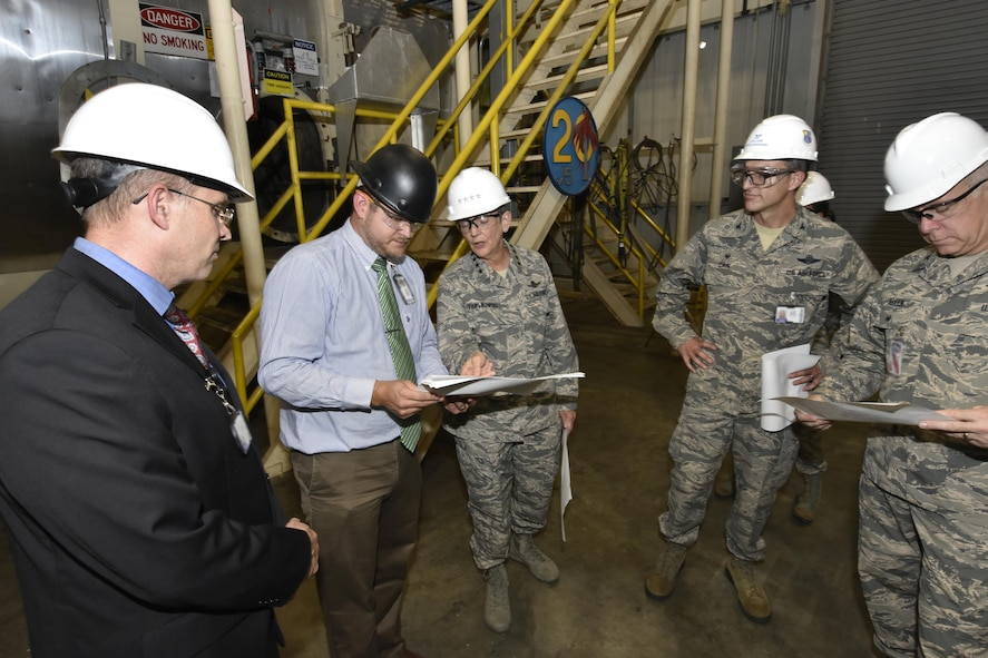 Gen. Ellen M. Pawlikowski, Air Force Materiel Command commander (center), and Col. Scott Cain, Arnold Engineering Development Complex commander (right of center), receive a facility briefing and tour of the AEDC J5 Rocket Motor Test Facility by AEDC staff members Aug. 22, 2017. (U.S. Air Force photo/Rick Goodfriend) (This image was manipulated by obscuring badges for security purposes.)