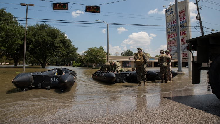 Marines with Charlie Company, 4th Reconnaissance Battalion, 4th Marine Division, Marine Forces Reserve, ready their Marine Corps F470 Zodiacs Combat Rubber Raiding crafts for rescue missions in Houston, Texas, Aug. 31, 2017. Marines from Charlie Company assisted rescue effort in wake of Hurricane Harvey by providing Zodiacs and personal to local law enforcement.