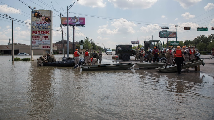 Marines with Charlie Company, 4th Reconnaissance Battalion, 4th Marine Division, Marine Forces Reserve and Texas State Guardsmen, ready their boats for rescue missions in Houston, Texas, Aug. 31, 2017. Marines from Charlie Company assisted rescue effort in wake of Hurricane Harvey by providing Zodiacs and personal to local law enforcement.