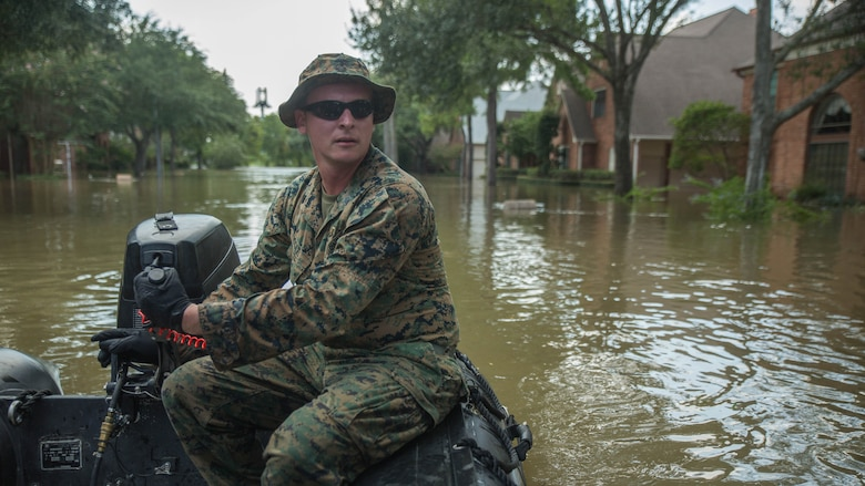 Marine Corps Sgt. Brad Coats, a reconnaissance Marine with Charlie Company, 4th Reconnaissance Battalion, 4th Marine Division, Marine Forces Reserve, steers a Marine Corps F470 Zodiacs Combat Rubber Raiding craft through a flooded street in Houston, Texas, Aug. 31, 2017. Marines from Charlie Company assisted rescue effort in wake of Hurricane Harvey by providing Zodiacs and personal to local law enforcement.