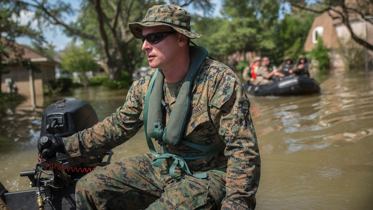 Marine Corps Sgt. Brad Coats, a reconnaissance Marine with Charlie Company, 4th Reconnaissance Battalion, 4th Marine Division, Marine Forces Reserve, steers a Marine Corps F470 Zodiacs Combat Rubber Raiding craft through a flooded street in Houston, Texas, Aug. 31, 2017. Hurricane Harvey landed Aug. 25, 2017, flooding thousands of homes and displaced over 30,000 people.