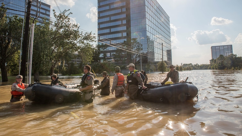 Marines with Charlie Company, 4th Reconnaissance Battalion, 4th Marine Division, Marine Forces Reserve, along with members of the Texas Highway Patrol and Texas State Guard, pull Marine Corps F470 Zodiacs Combat Rubber Raiding crafts through a flooded street in Houston, Texas, Aug. 31, 2017. Marines from Charlie Company assisted rescue effort in wake of Hurricane Harvey by providing Zodiacs and personal to local law enforcement.
