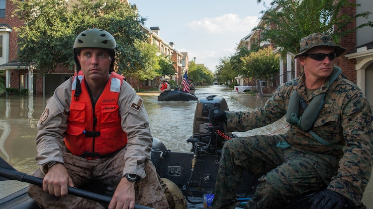 Warrant Officer Aaron Grigsby (left), a diver with the Texas State Guard, and Marine Corps Sgt. Brad Coats (right), a reconnaissance Marine with Charlie Company, 4th Reconnaissance Battalion, 4th Marine Division, Marine Forces Reserve, navigate through a flooded apartment complex in Houston, Texas, Aug. 31, 2017. Hurricane Harvey landed Aug. 25, 2017, flooding thousands of homes and displaced over 30,000 people.