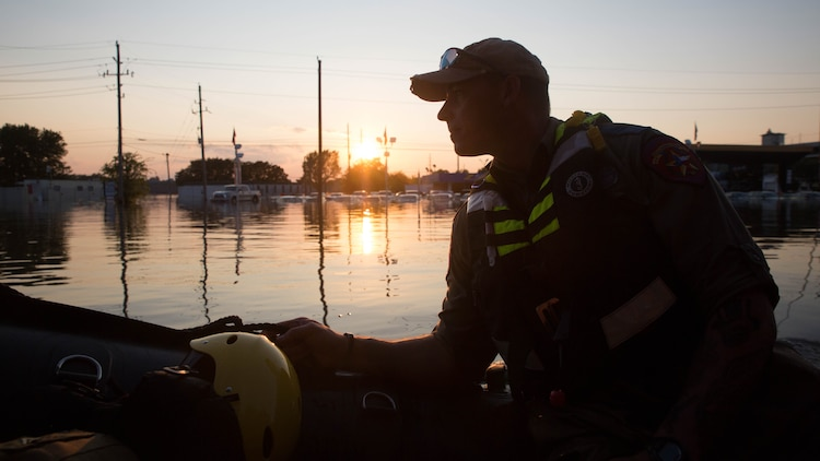 William Boston, a trooper with the Texas Highway Patrol, looks out over a flooded street aboard a Marine Corps F470 Zodiacs Combat Rubber Raiding crafts in Houston, Texas, Aug. 31, 2017. Marines from Charlie Company, 4th Reconnaissance Battalion, 4th Marine Division, assisted rescue effort in wake of Hurricane Harvey by providing Zodiacs and personal to local law enforcement.