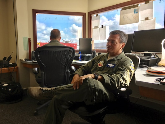 Col. Harry Hughes, a reservist assigned as Emergency Preparedness Liaison Officer to the Federal Emergency Management Agency-Region 8, listens to a Hurricane Harvey relief effort update at Joint Base San Antonio-Seguin Auxiliary Airfield Sept. 5, 2017.  Helping local response agencies coordinate with one another is a primary responsibility for EPLOs. (U.S. Air Force photo by Dan Hawkins)