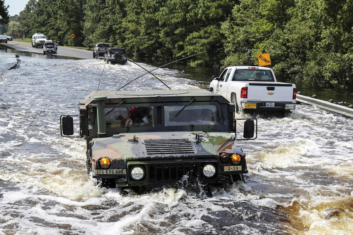 Soldiers drive on flooded roads as they continue rescue missions.