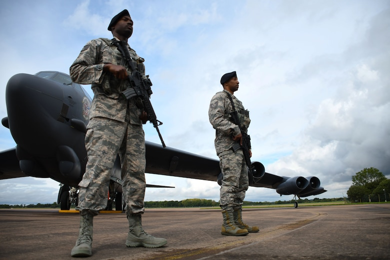 Airmen of the 307th Security Forces Squadron guard a B-52 Stratofortress at Royal Air Force Fairford, United Kingdom, Sep. 4, 2017.